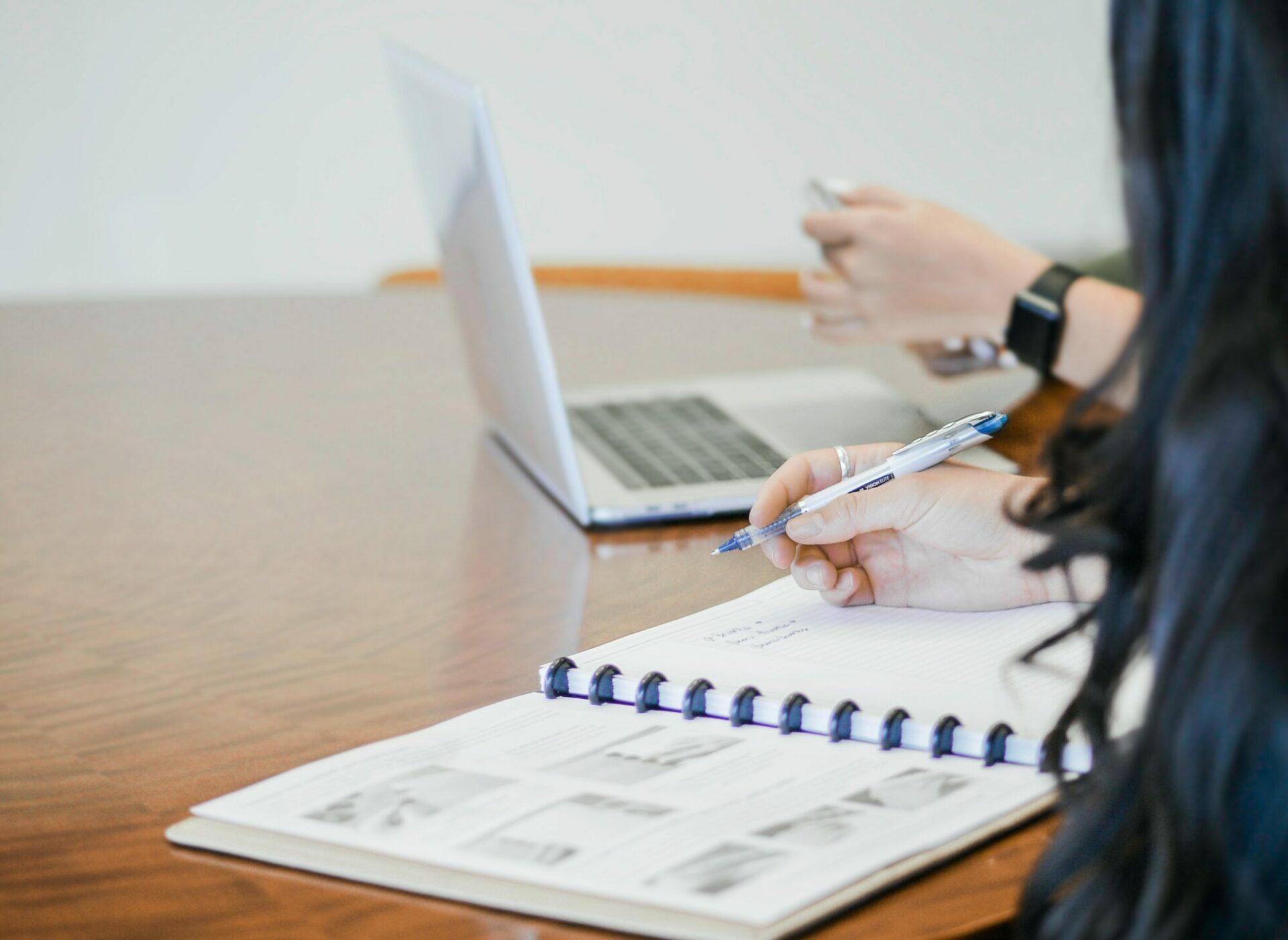 Business woman at desk with bank balance sheet